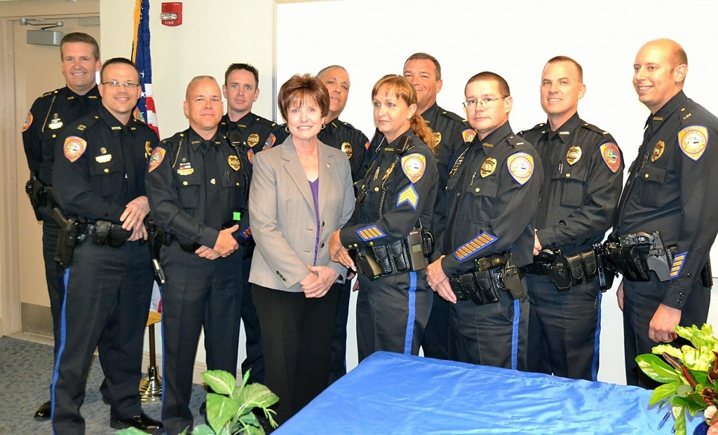 Members of the Punta Gorda Police Department Leadership Team: (from left to right) Chief Butch Arenal, Captain Tom Lewis, Lieutenant Chris Salsman, Lieutenant Jeff Woodard, Executive Assistant Beverly Marquis, Lieutenant James Kirdy, Lieutenant Melissa Reynolds, Lieutenant Joe King, Lieutenant Rick Mohaupt, Lieutenant David Lipker, and Captain Jason Ciaschini