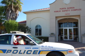 Santa rode with Punta Gorda Police Officer Dean Irving last year. He will return for another patrol of the City on the 18th and 23rd of December.