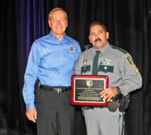 Collier County Sheriff Kevin Rambosk, left, presented Cpl. Ken Vila with the 2015 Florida D.A.R.E. Officer of the Year award Monday in Orlando. In August, Cpl. Vila will travel to New Orleans where he will be honored by D.A.R.E. America with the 2015 National D.A.R.E. Officer of the Year award. Photo by Cpl. Debra Gross/CCSO